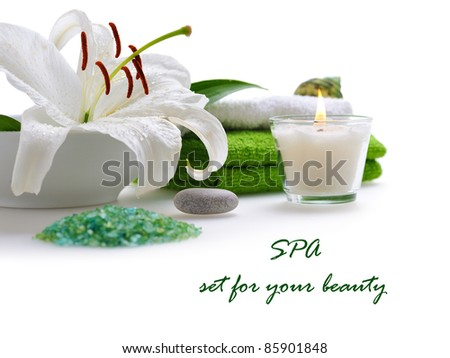 spa with white lily on white background - stock photo