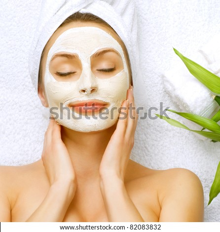 Spa Woman applying Facial cleansing Mask. Beauty Treatments - stock photo