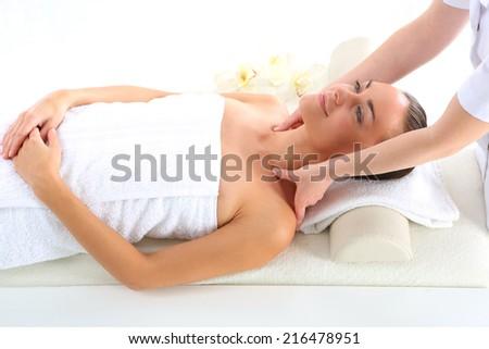 Spa - woman at massage .Attractive brunette woman in spa salon. - stock photo