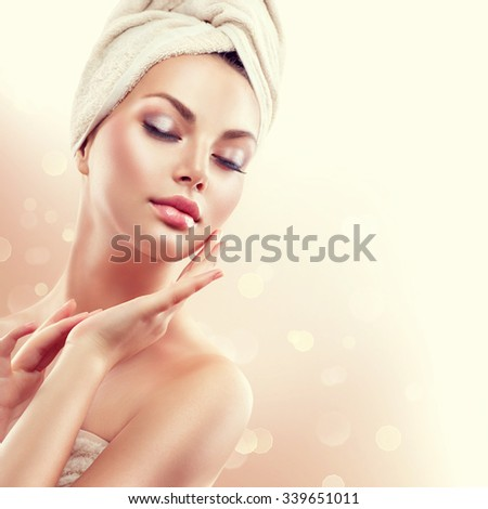 Spa Woman. Beautiful Girl After Bath Touching Her Face. Perfect Skin. Skincare. Young Skin - stock photo