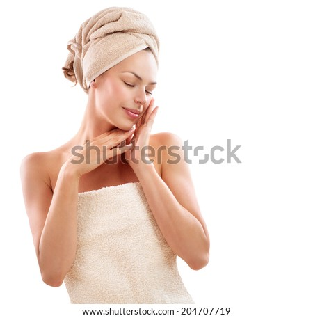 Spa Woman. Beautiful Girl After Bath Touching Her Face. Perfect Skin. Skincare. Young Skin. Beauty lady with towel on her headtouching her soft skin. Pampering. Treatment  - stock photo