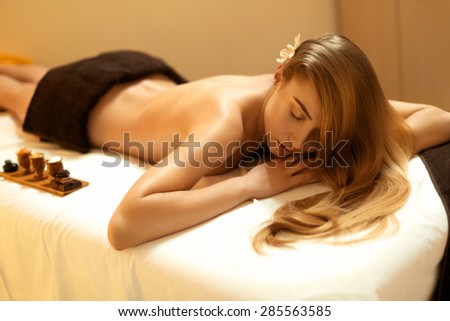 Spa Woman. Blonde Gets Recreation Treatment in Spa Salon. Wellness Concept