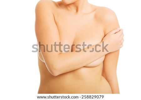 Spa woman covering her breast with crossed hands