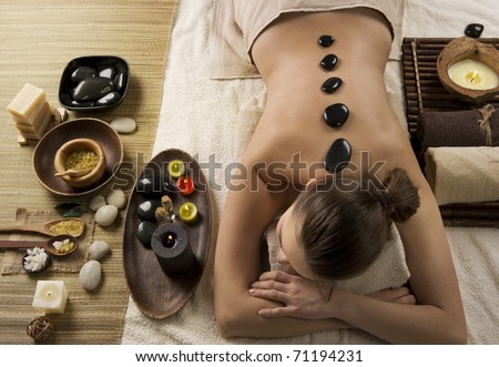 Spa Woman.Hot Stones Massage.Beauty salon - stock photo