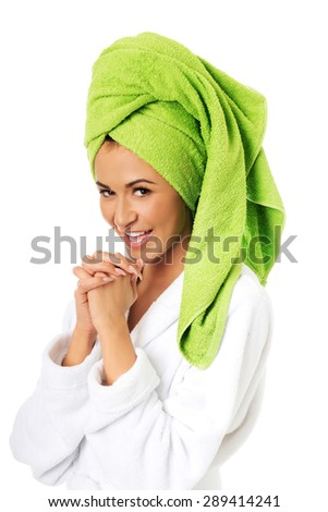 Spa woman in bathrobe clenching hands. - stock photo