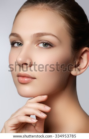 Spa woman. Natural beauty face. Beautiful girl touching her face. Perfect skin. Skincare. Young Skin. Manicured nails. Cosmetics & makeup - stock photo