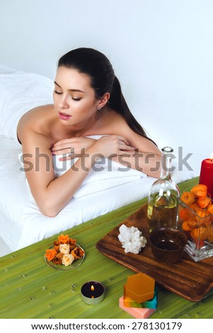 Spa Woman on White and Bamboo at Salon - stock photo