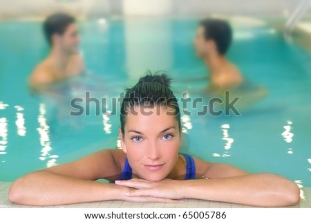 spa woman portrait relaxed in pool water men in background - stock photo