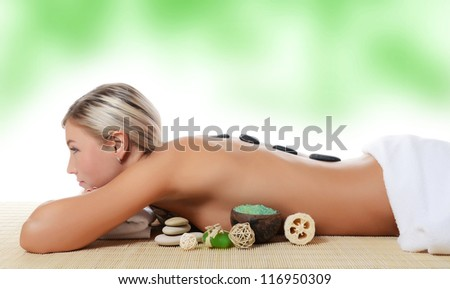 Spa Woman.  Stone Massage isolated on white - stock photo