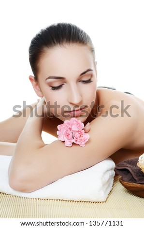Spa Woman. Stone Massage isolated on white. Skincare - stock photo