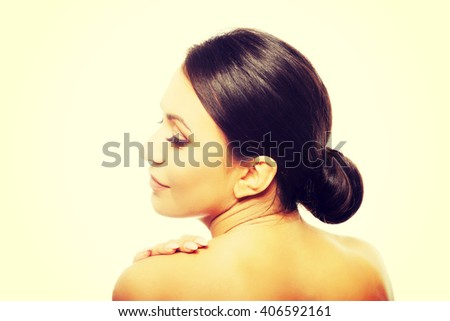 Spa woman touching her shoulder - stock photo