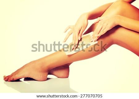 Spa woman waxing her leg - stock photo