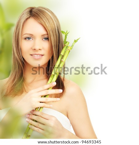 Spa woman with bamboo. Clear fresh skin - stock photo