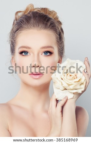 Spa Woman with Blonde Hair and White Rose Flower. Skin Care Concept - stock photo