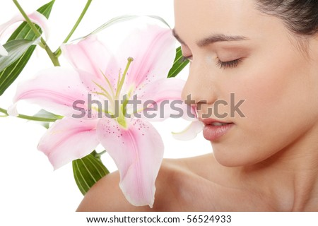 Spa woman with flower in white background - stock photo