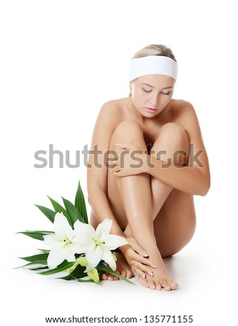 Spa Woman with flowers of lily isolated on white - stock photo