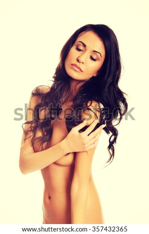 Spa woman with folded arms covering breast