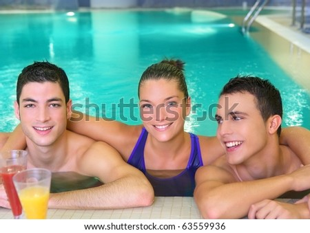 spa young friends group smiling in turquoise pool water - stock photo