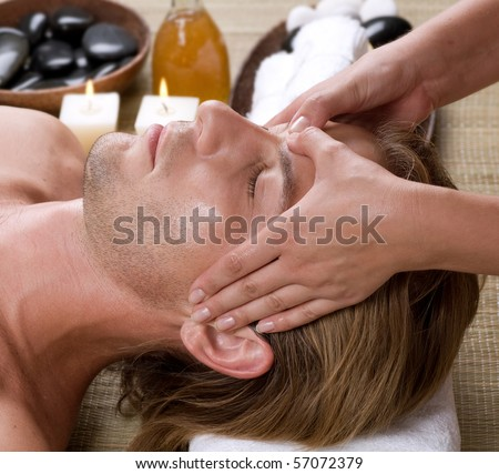 Spa.Young Man getting Face Massage. - stock photo
