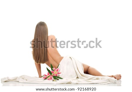 spa young woman wearing only towel, isolated on white background - stock photo