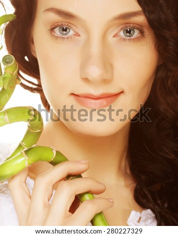 SPA. young woman with bamboo. Isolated on white. - stock photo