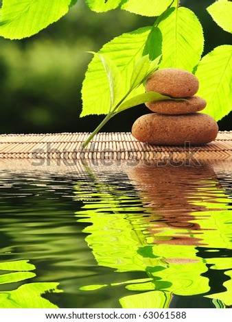spa zen or summer concept with stone and water - stock photo