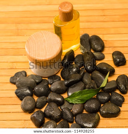 Spa zen stones with salt and oil still nature setting - stock photo