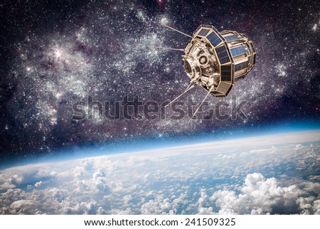 Space satellite orbiting the earth. Elements of this image furnished by NASA. - stock photo