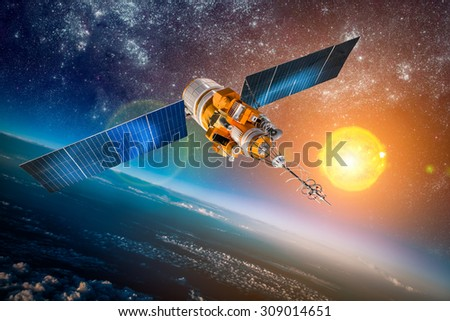 Space satellite orbiting the earth on a background star sun. Elements of this image furnished by NASA.