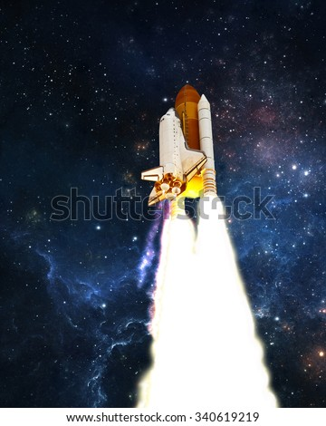 Space Shuttle launches into outer space. Elements of this image furnished by NASA. - stock photo