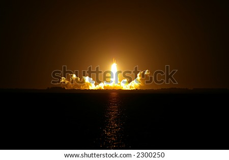 Space Shuttle Night Launch. STS-116 Discovery launching from Cape Kennedy. - stock photo