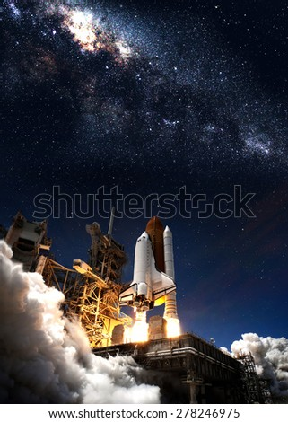 Space shuttle taking off on a mission. Elements of this image furnished by NASA - stock photo