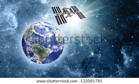 "Space station over blue planet earth in space. ""Elements of this image furnished by NASA"" - stock photo"