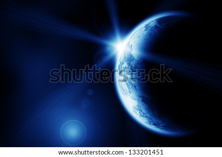 Space sunrise above the Earth planet. The Earth texture of this image furnished by NASA. (http://visibleearth.nasa.gov/view.php?id=57735) - stock photo