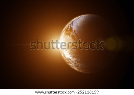 Space sunrise on a starless background. Elements of this image furnished by NASA. - stock photo