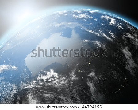Space view of the sun rising over Australia on blue planet Earth. Elements of this image furnished by NASA. - stock photo
