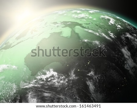 Space view of the sun rising over Australia on green planet Earth. Elements of this image furnished by NASA.