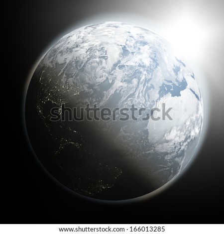 Space view of the sun rising over northern hemisphere on blue planet Earth. Elements of this image furnished by NASA. - stock photo