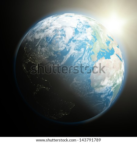 Space view of the sun rising over northern hemisphere on planet Earth. Elements of this image furnished by NASA. - stock photo