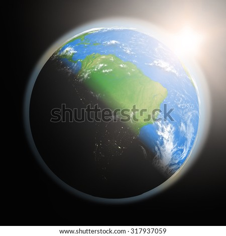 Space view of the sun rising over South America on planet Earth. Elements of this image furnished by NASA. - stock photo