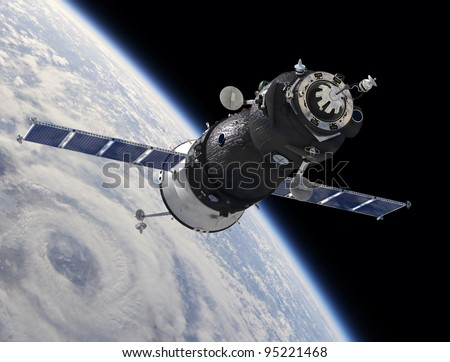 Spaceship at the Earth orbit - stock photo