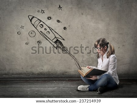 Spaceships flying out of books  - stock photo