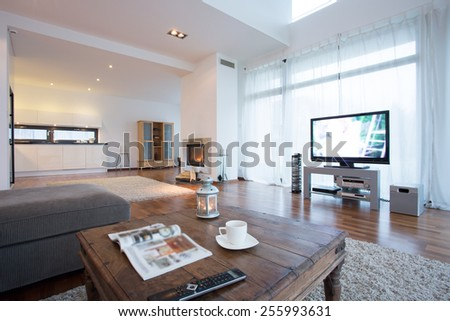 Spacious and bright living room with tv in residence - stock photo