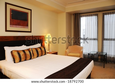 Spacious and nicely decorated room. Brown Theme with King Bed