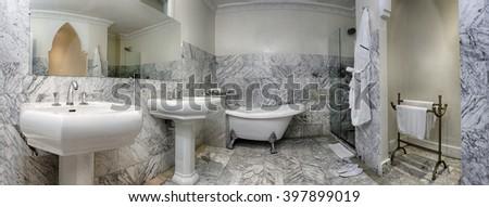 Spacious bathroom of a luxury suite - stock photo