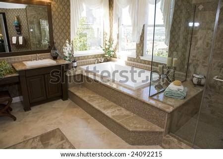 Spacious bathroom with a modern tub and tile floor. - stock photo