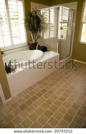 Spacious bathroom with a tile floor. - stock photo
