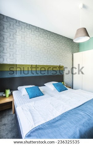 Spacious bedroom with twin bed in hotel room - stock photo