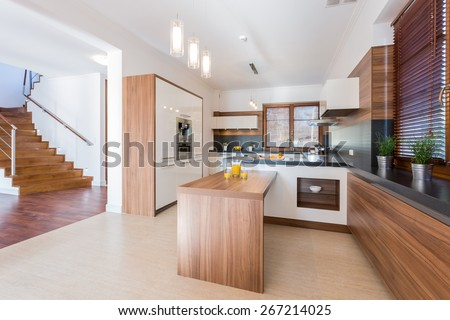 Spacious bright kitchen with wooden units - stock photo