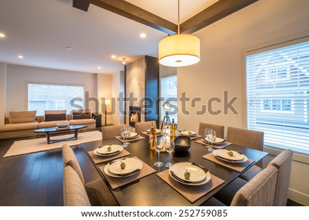 Spacious bright living room and dining room with a fireplace. Interior design. - stock photo